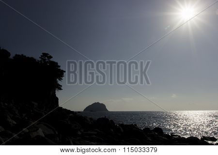 Backlight On Sky With Ocean And Cliff