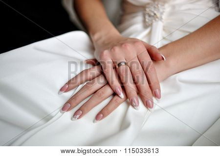 Hands Of A Bride With A Wedding Ring