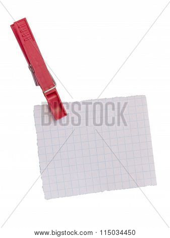 torn-off sheet of a notebook hanging on clip