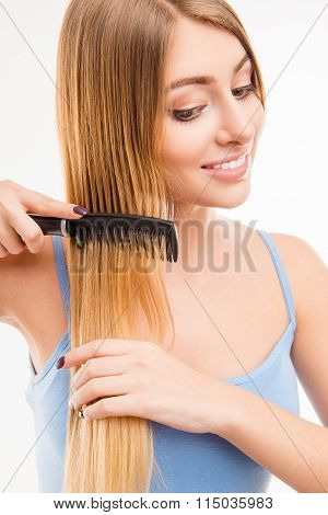Girl Combing Her Hair, Close Up Photo