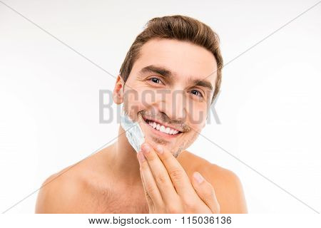 Handsome Young Man Smearing Shaving Foam On His Chin