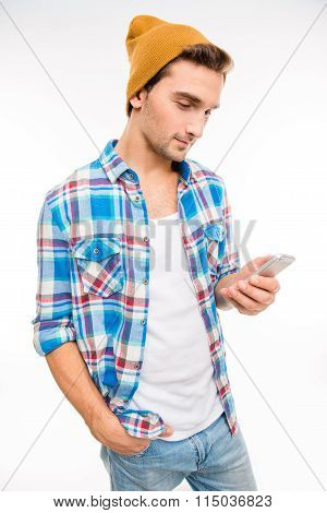 Young Hipster With Mobile Phone Holding Hand In Pocket