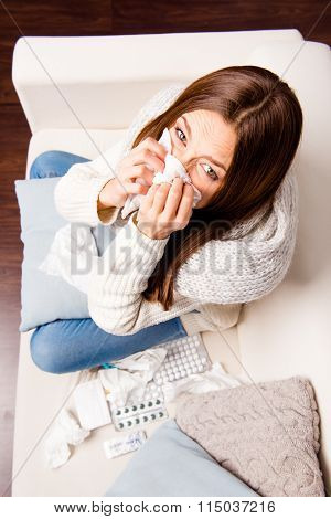 Top View Photo Of Girl Sneezing In Tissue