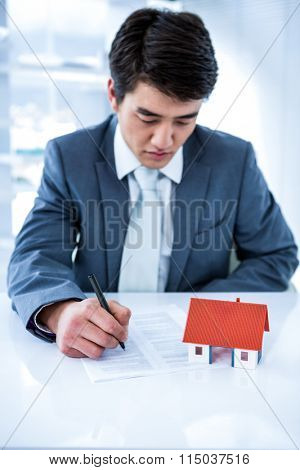 Asian businessman read a estate contract in his office