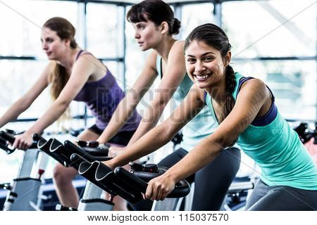 Fit woman working out at spinning class in the gym