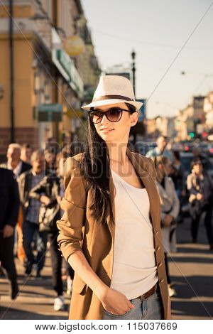Beautiful Stylish Girl Stands Among The Bustle Of The City