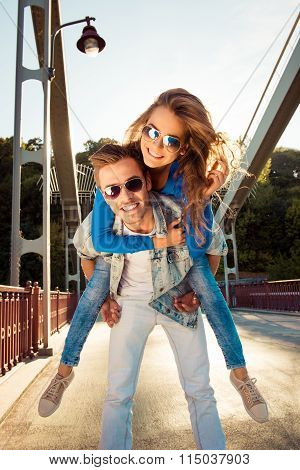 Positive Couple In Love On The Bridge With Glasses