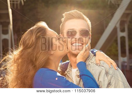 Romantic Couple In Love On The Bridge Huging Together