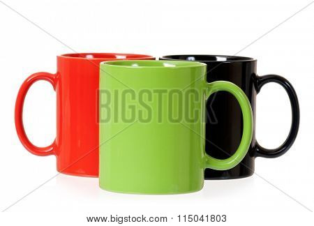Three mugs for coffee or tea, isolated on white background