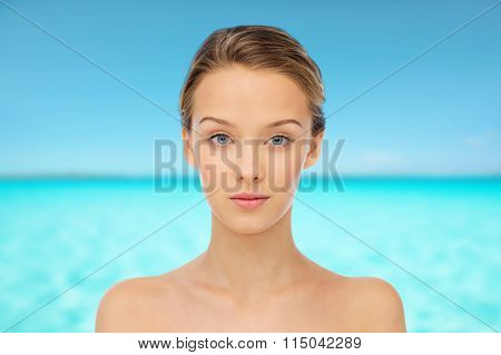 young woman face over blue sea nd sky