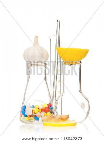 Test tubes with colorful pills slice lemon and garlic, isolated on white background