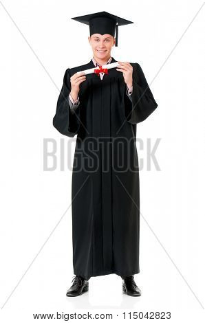 Handsome graduate guy student in mantle with diploma, isolated on white background