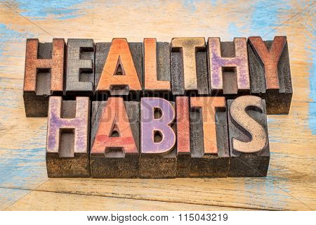 healthy habits words in vintage letterpress wood type printing blocks against painted wood