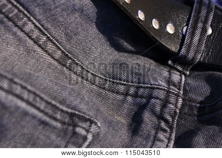 gray jeans with a leather belt