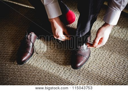 The Groom Wears Black Shoes In The Hotel