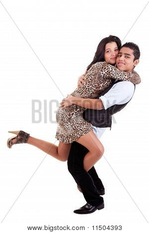 Young Couple In Love, Hugging, Man Holding His Beloved, Isolated On White, Studio Shot