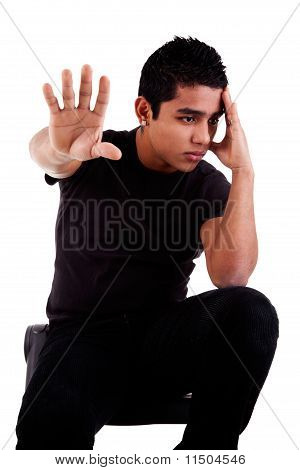 Young Latin Man, Pensive, With His Hand In Stop Signal, Isolated On White Background, Studio Shot