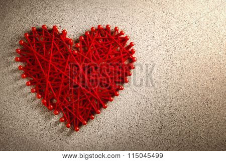 Red heart made from wool pinned into corkboard,Valentines day concept.