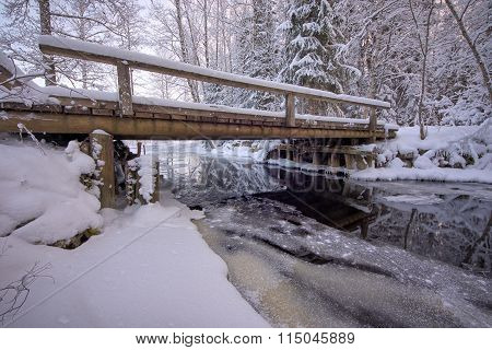 Bridge And Frozen River