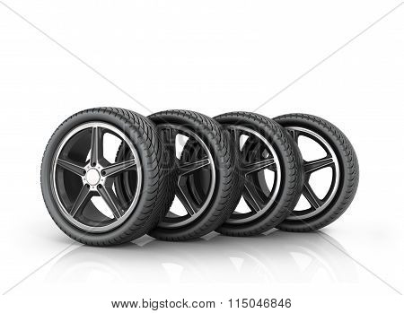 Four Car Wheels On A White Background.