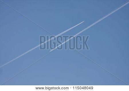 Two Jet tracks in opposite direction.