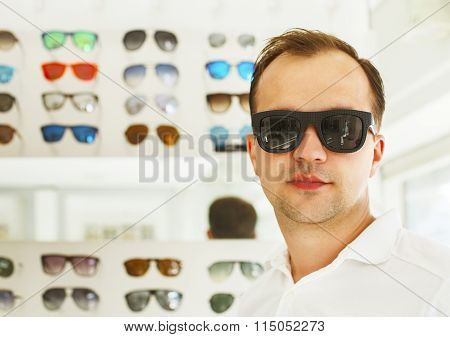 Man Trying On New Sunglasses At The Opticians