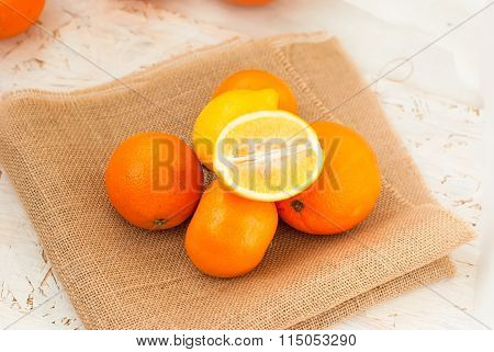 Oranges And Lemons Pile On The Table