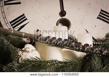 Old Flute Near A New Year Clock