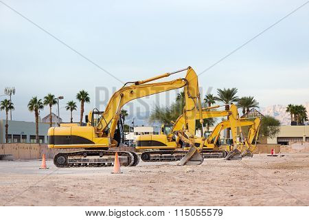 Tree excavators at construction site.