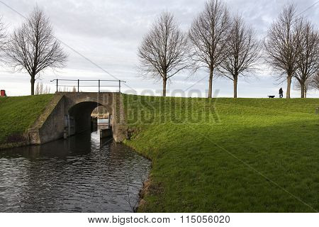 Dike With Historic Bridge And Sluice