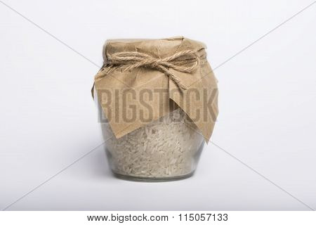 Raw Rice In A Jar Isolated On Whit