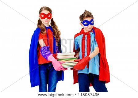 Boy and girl teenagers in a costume of superheroes holding books. Isolated over white background.