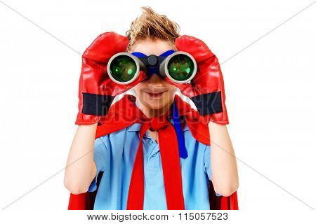 A boy teenager in a costume of superhero looking through binoculars. Isolated over white background.