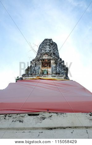Ancient stupa in temple of Thailand with blue sky background