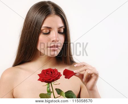 Cute Beautiful Woman Tears Off Petals Of Red Rose On White Background