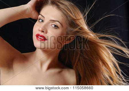 Fashion Portrait Of Attractive Blonde Woman With Red Lips And Windy Hair On Black Background
