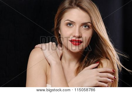 Fashion Portrait Of Attractive Young Blonde Woman With Red Lips On Black Background