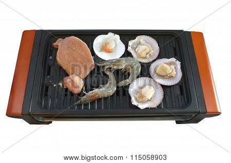 Seafood on enamel grilled stove