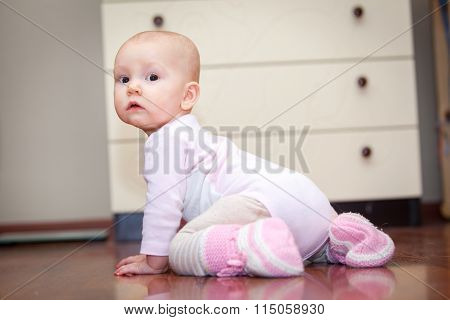 small child on the floor, who was crying, but does not scream. A tear rolling down his cheek. Blurre