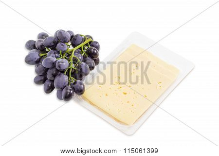 Blue Grapes And Cheese On A Light Background