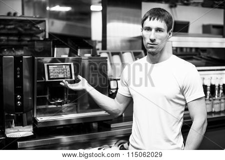 Young barista show professional coffee maker
