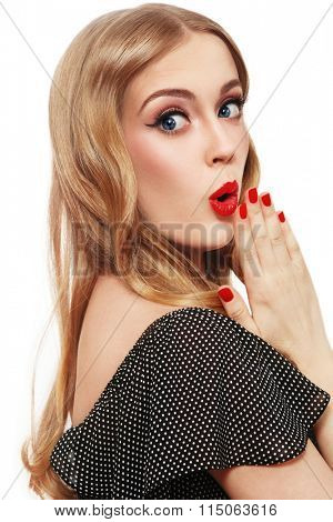 Young beautiful blonde girl with shocked expression over white background