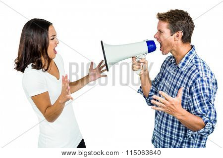 Couple shouting with man holding megaphone on white background