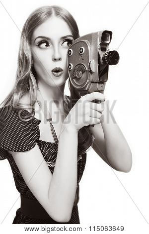 Duotone shot of young beautiful curious girl with vintage camera over white background, copy space