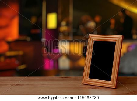 photo frame on the wooden table on table in a night club