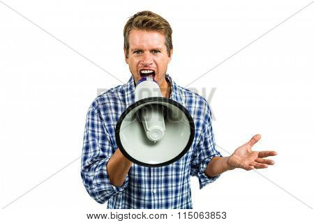 Portrait of man shouting through megaphone while standing against white background