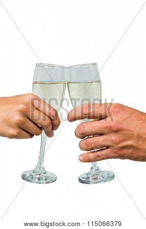Cropped hand of couple toasting champagne flute against white background