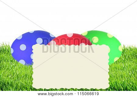 Colorful Painted Easter Eggs In Green Grass And Card Isolated On White