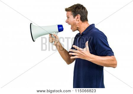 Side view of angry man shouting through megaphone against white background