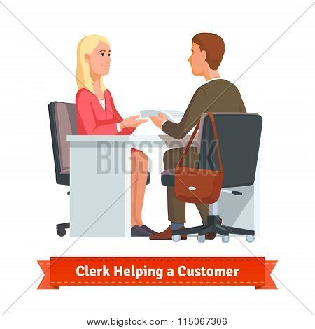 Office clerk working with customer